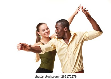 Young couple dances social Caribbean Salsa, studio shot isolated on white background. Positive human emotions. black african and Caucasian models