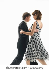 young couple dancing argentinian tango, on white background