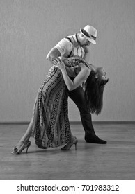 The young couple dancing in empty room