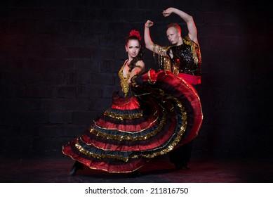 young couple dancing flamenco, studio shot.