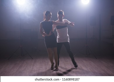 Young couple dancing latin dance Bachata, merengue, salsa. Two elegance pose in dance class