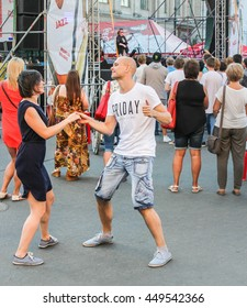 Young couple dancing to the music. St. Petersburg, Russia - 2 July, 2016. Annual international festival of jazz and blues in St. Petersburg.