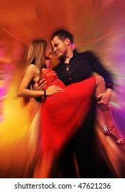 Young couple dancing in the night club