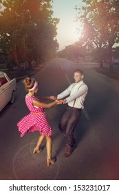 Young couple dancing on the highway