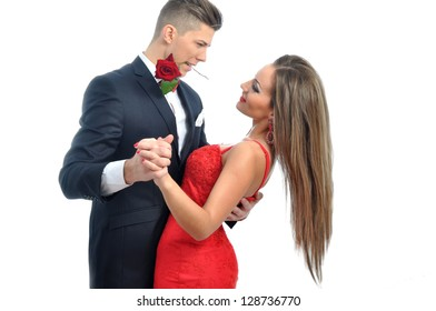 Young couple dancing with red rose