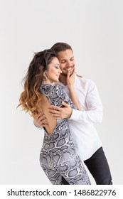 Young couple dancing social latin dance bachata, merengue, salsa. Two elegance pose on white background