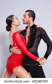 young couple dancing, studio shot