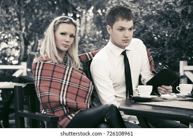 Young couple dining at a sidewalk cafe