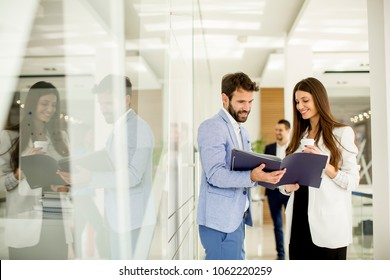 Young couple discussing about business in the modern office