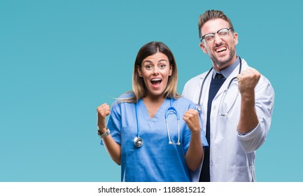 Young couple of doctor and surgeon over isolated background very happy and excited doing winner gesture with arms raised, smiling and screaming for success. Celebration concept.