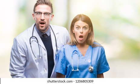 Young couple of doctor and surgeon over isolated background afraid and shocked with surprise expression, fear and excited face.