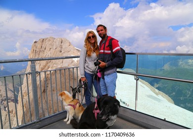 Young couple with dog on Punta Rocca, Marmolada