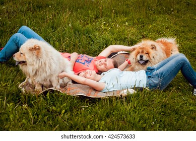 Young couple with the dogs in the park.