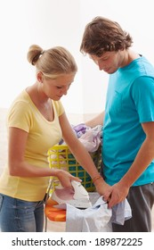 A young couple doing the ironing together