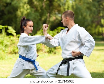 Young couple doing Martial Arts exercise in nature