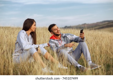 Young couple doing a selfie after jogging in nature