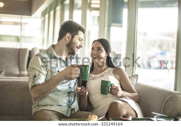 Young Couple Drink Coffee Handsome Man Stock Photo (Edit Now) 335244164
