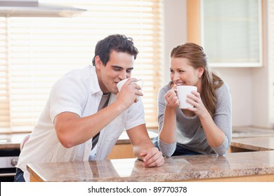 Young couple drinking in the kitchen