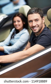 Young couple driving a car