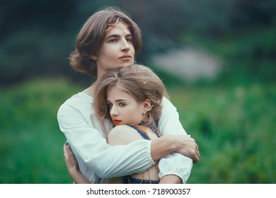 Young couple of elves in love standing in magical forest on the meadow outdoor on nature. Fairy tale of love, relationship and magik people concept. Man ambracing woman