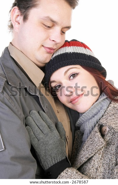 Young couple embracing; isolated on white.