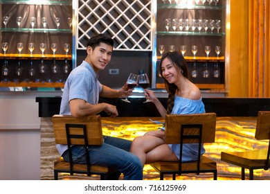 young couple enjoy night to dringking wine at home