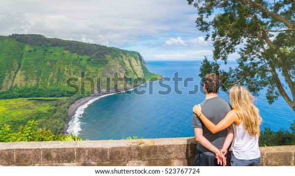 Young couple enjoying the amazing view in Waipio Valley, Big Island, Hawaii, Usa