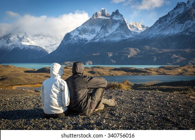 Young couple enjoying the a beautiful scenario in Torres del Paine National Park, Patagonia, Chile