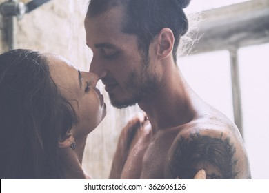 young couple enjoying each other in the shower