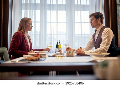 A young couple enjoying lunch in a relaxed atmosphere at the restaurant. Couple, love, restaurant, together