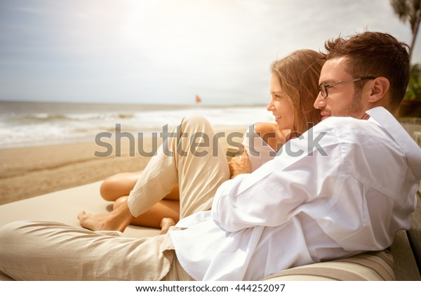Young couple enjoying on beach at tropical resort