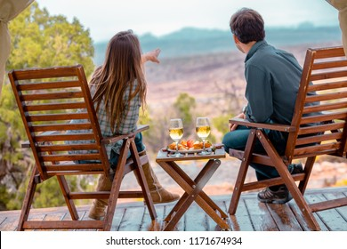 A Young Couple Enjoying The Outdoors While Luxury Camping
