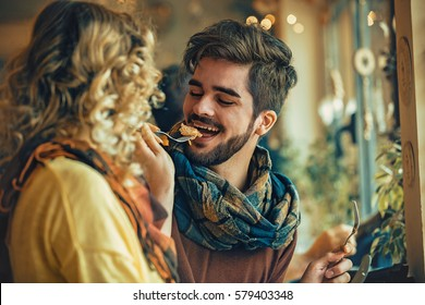 Young couple enjoying restaurant.