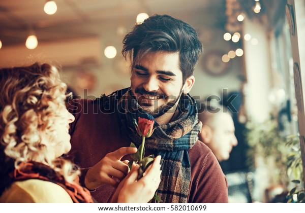 Young couple enjoying restaurant.