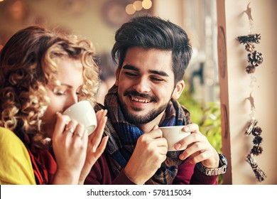 Young couple enjoying restaurant and drinking coffee.