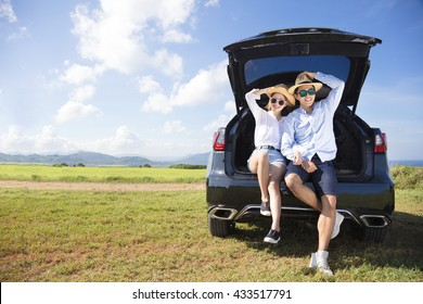 young couple enjoying road trip and summer vacation