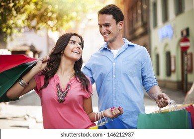 Young couple enjoying shopping together