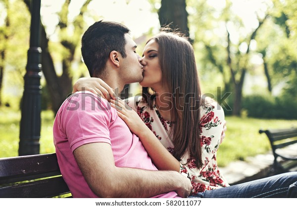 Young couple enjoying spring in the park.
