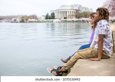 Young couple enjoying Springtime in Washington DC Peak Bloom of the Cherry blossoms