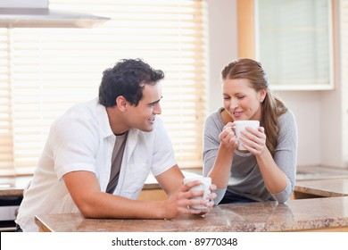 Young couple enjoying tea in the kitchen