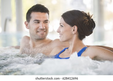 Young couple enjoying thermal bath in thalassotherapy center