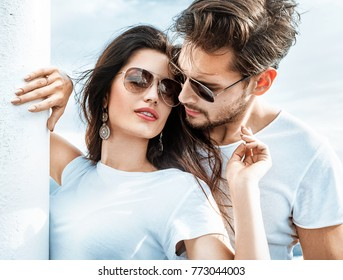 Young couple enjoying vacation at beach with copy space