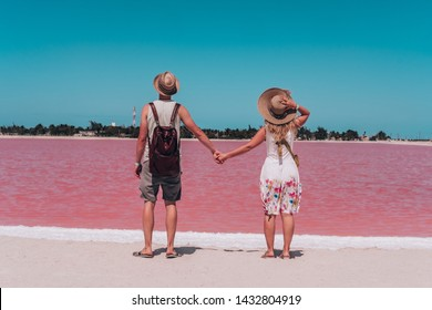 Young couple enjoying the view on the pink lakes in Mexico. Las Coloradas, Yucatan. Mexican vacation. Best things to visit in Yucatan Peninsula.