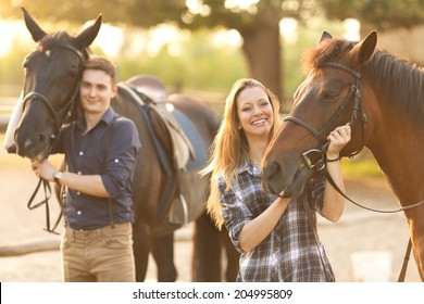 Young couple enjoys spending time with horses