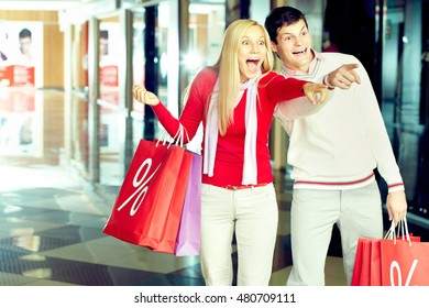 Young couple is excited at what they see in the shop