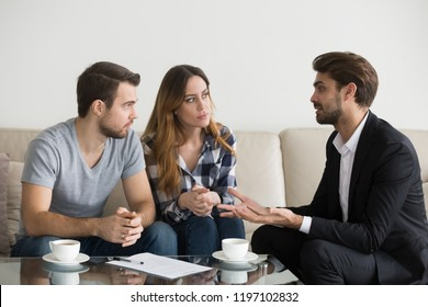 Young couple, family at meeting with realtor, interior designer, decorator, landlord, banker, financial advisor. Employee consulting, explaining. Decision making, doubting client, customer