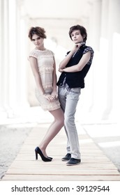Young couple fashion. On bright white outdoors background.