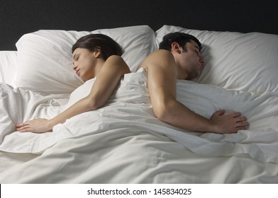 Young couple fast asleep in bed
