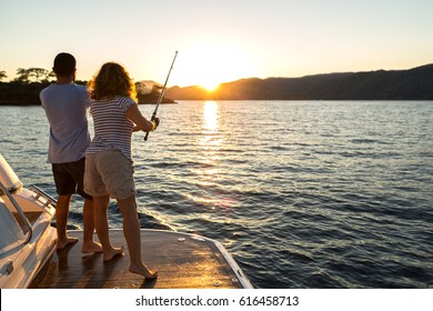 A Young Couple Fishing at Sunset