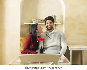 Young couple flirting in a cafe